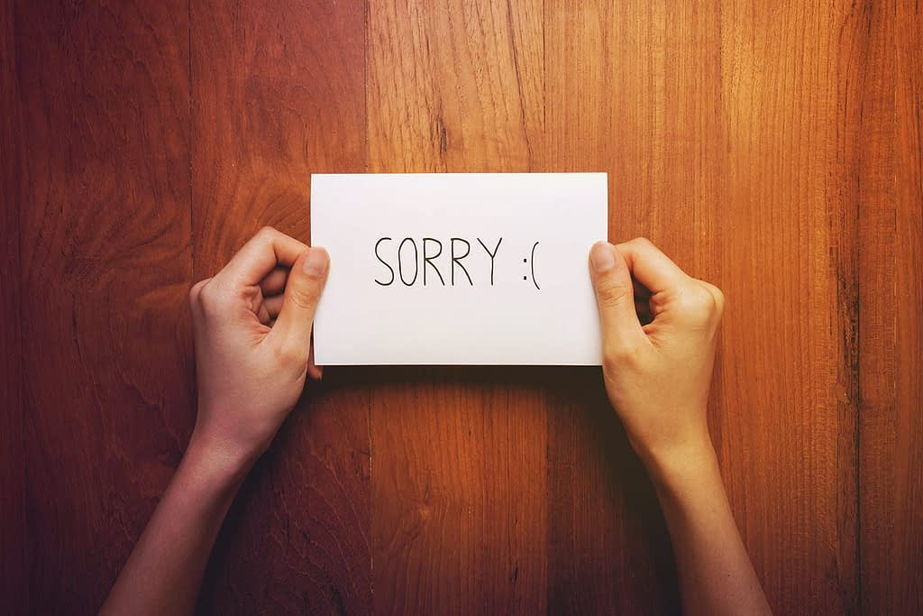 Image: Notecard with the words 'Sorry'